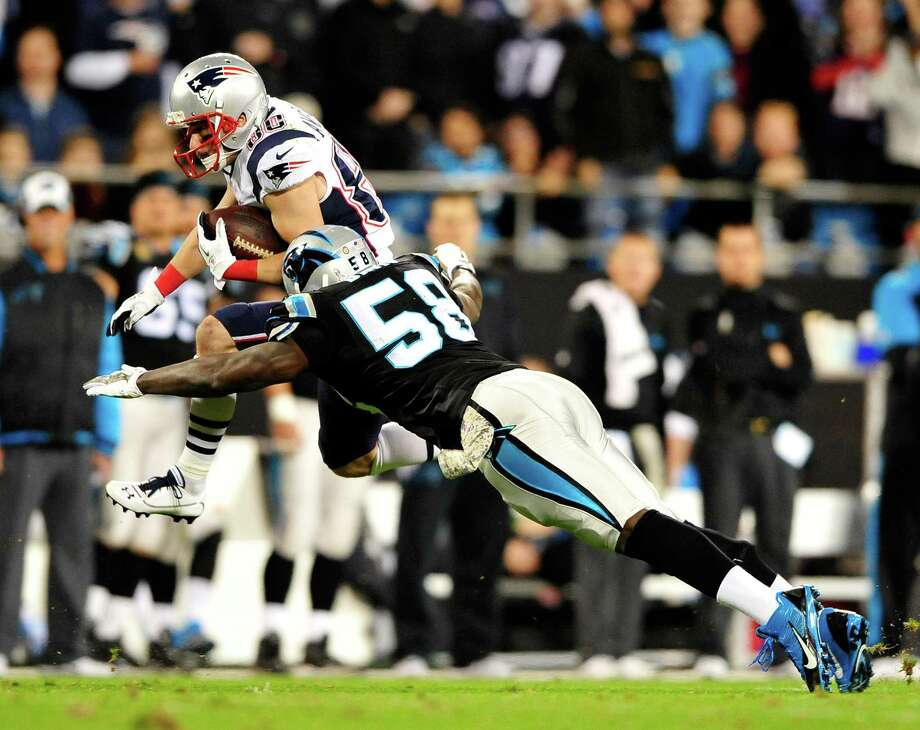 CHARLOTTE, NC - NOVEMBER 18:  Danny Amendola #80 of the New England Patriots is tackled by Thomas Davis #58 of the Carolina Panthers during play at Bank of America Stadium on November 18, 2013 in Charlotte, North Carolina.  (Photo by Grant Halverson/Getty Images) ORG XMIT: 184892950 Photo: Grant Halverson / 2013 Getty Images