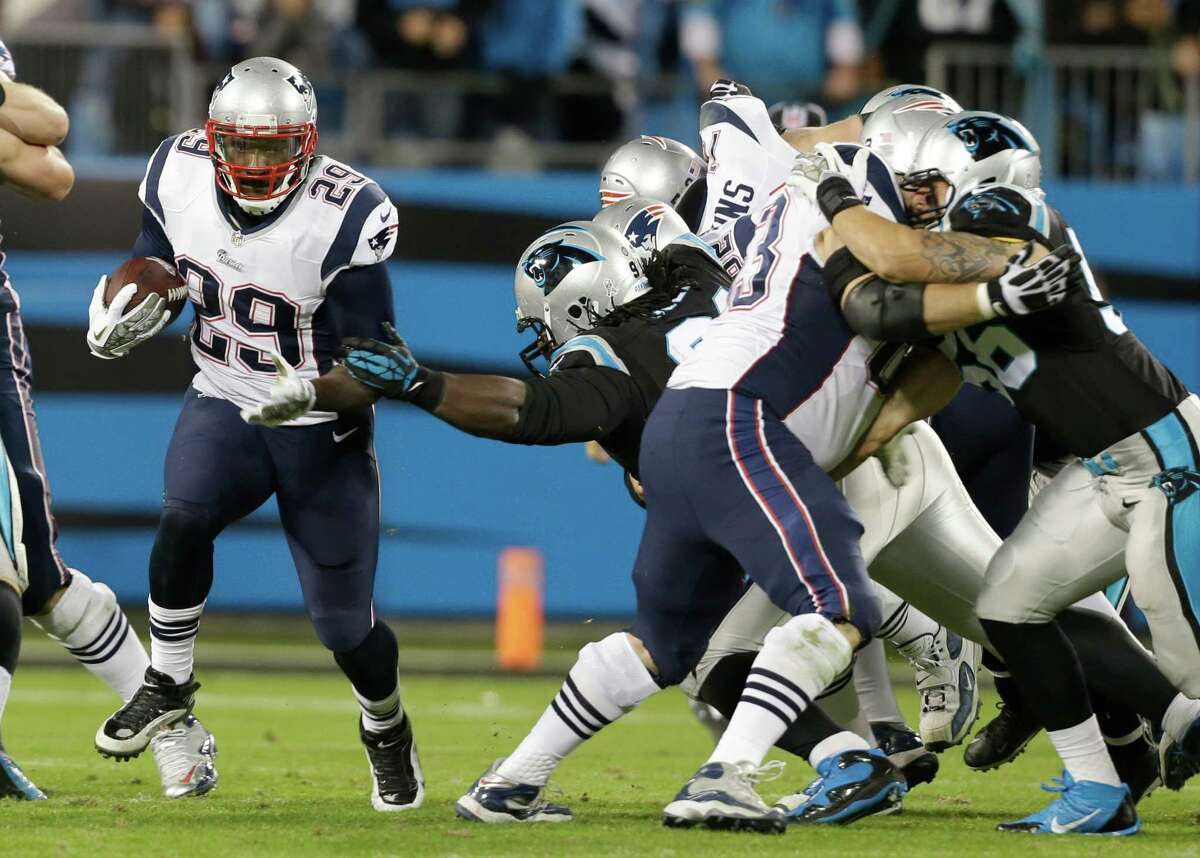 New England Patriots' LeGarrette Blount (29) runs past the Carolina Panthers during the second half of an NFL football game in Charlotte, N.C., Monday, Nov. 18, 2013. (AP Photo/Gerry Broome) ORG XMIT: NCCB119