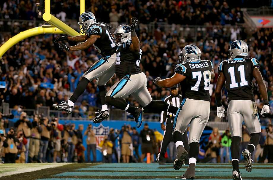 Carolina's Ted Ginn (left) leaps to celebrate his winning touchdown catch with Mike Tolbert. Photo: Streeter Lecka, Getty Images
