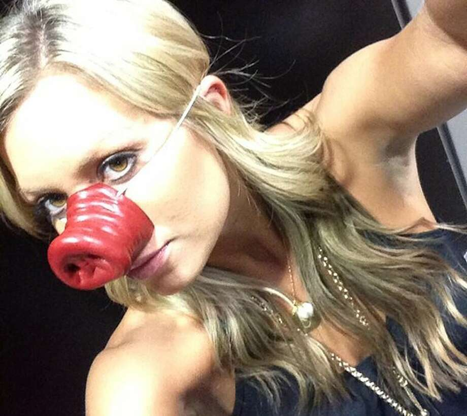 In one of the Hogs worst-ever seasons at least there's the wife of the coach to keep things interesting.  Thanks Jen.