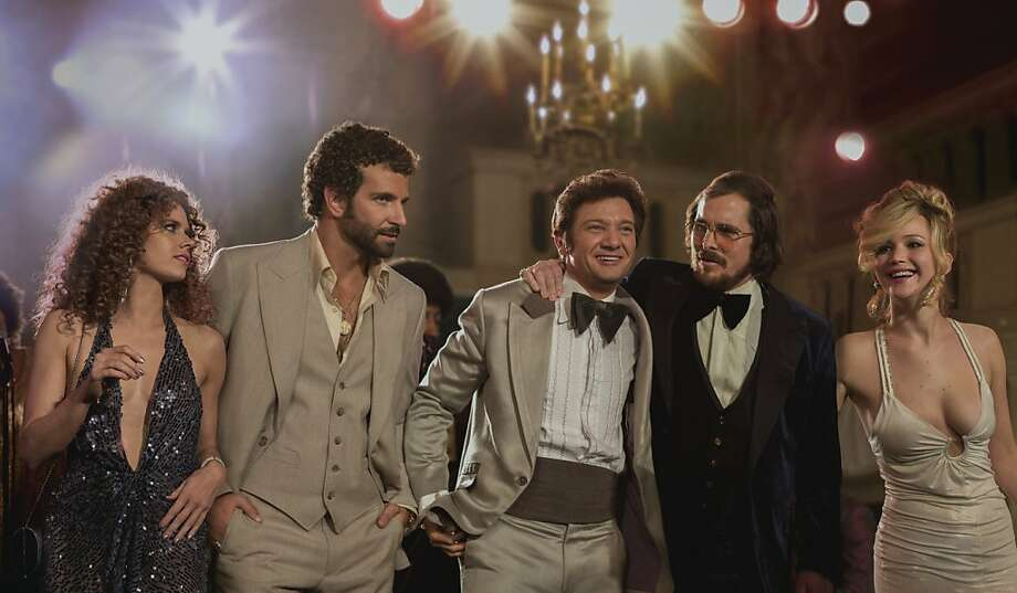 "Amy Adams (left), Bradley Cooper, Jeremy Renner, Christian Bale and Jennifer Lawrence are among the stars of ""American Hustle."" Photo: Sony Pictures"