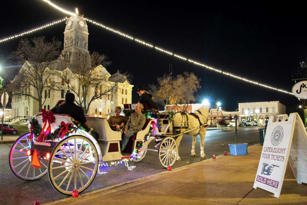 During Granbury's Historic Home Tour, horse-drawn carriages take visitors to 30 historic homes and buildings, lit by candles and decorated for the holidays.