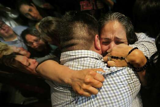Cassandra Rivera, right, holds a rosary as she embraces a relative after she and Elizabeth Ramirez,  and Kristie Mayhugh, left are released from prison at the Bexar County Jail. Anna Vasquez, above left, was released on parole from prison just over a year ago. Photo: Bob Owen, San Antonio Express-News / ©2013 San Antonio Express-News