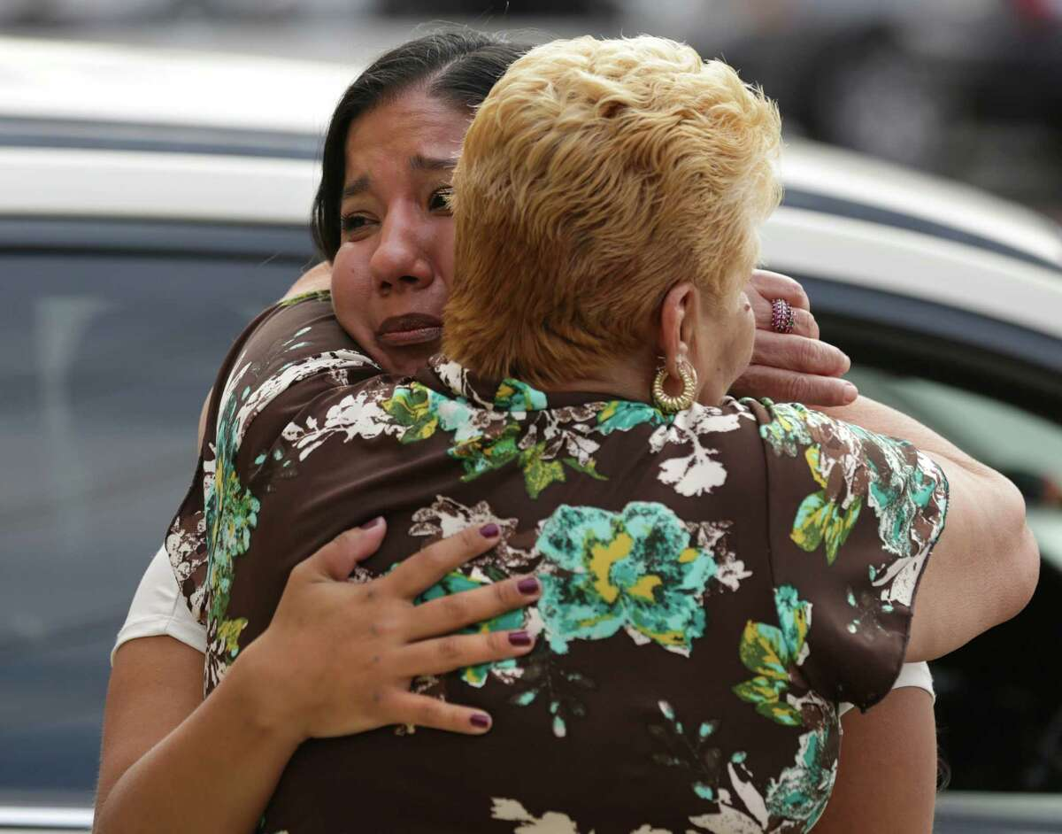 A tearful Stephanie Limon Martinez, left, embraces Gloria Herrera outside the Bexar County Jail where Elizabeth Ramirez, Cassandra Rivera and Kristie Mayhugh are released from prison, Monday, Nov. 18, 2013. The fourth women, Anna Vasquez, was released on parole from prison just over a year ago. Martinez was the youngest accuser of the four women and she recanted her accusation last year.
