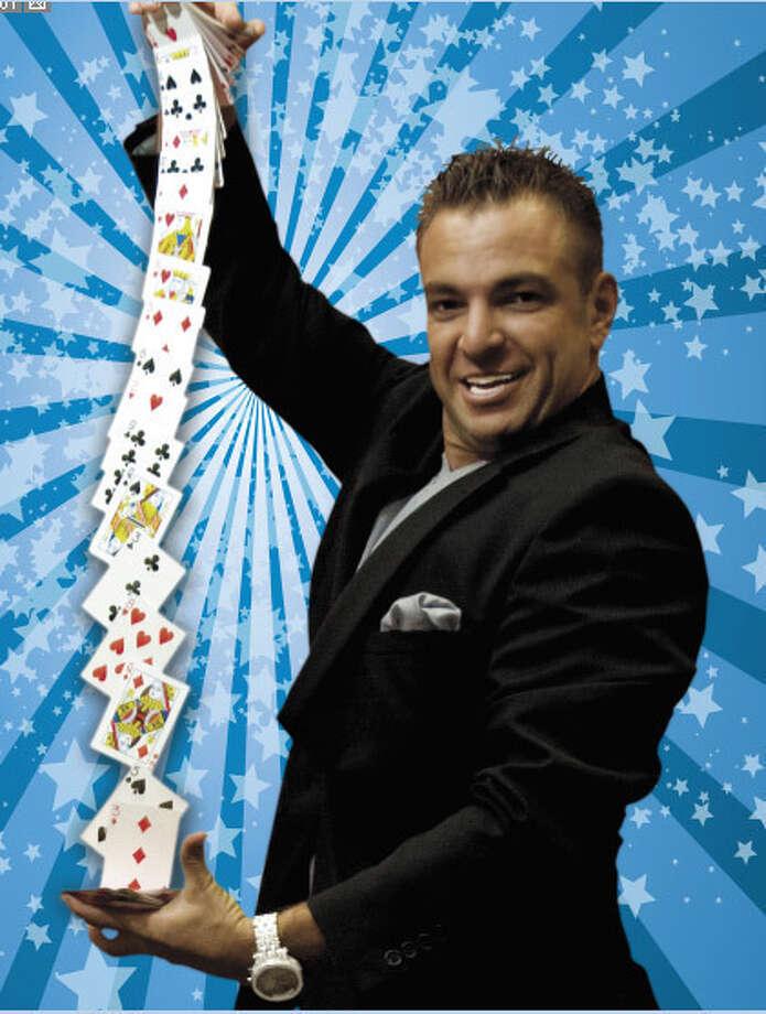 Amazing Adam dazzles audiences with sleight-of-hand tricks.