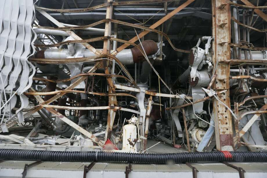 In this Nov. 7, 2013 file photo, the damaged Unit 4 reactor building at the Fukushima Dai-ichi nuclear power plant is seen in Okuma town, Fukushima prefecture, northeastern Japan. Tokyo Electric Power Co. began removing fuel rods Monday, Nov. 18, 2013 from unit 4, whose building was severely damaged but didn't have a core meltdown because the fuel had been removed for maintenance. Their goal is to remove the 1,533 sets of fuel rods in a pool on the building's top floor to safer storage. The utility hopes to remove all 3,100 fuel assemblies from storage pools at the four damaged units by 2018. Photo: Kimimasa Mayama, AP