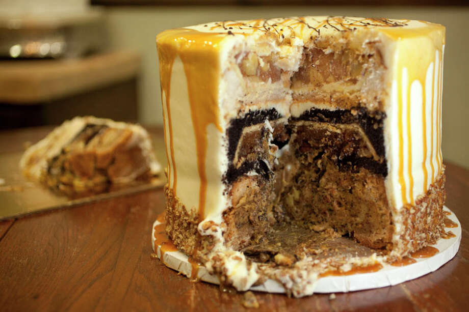The dessert is called the Pumpercapple. It's a three-layer cake and each layer has a pie baked into the cake batter: one layer has a pumpkin pie, the other has a pecan pie and the other an apple, hence Pumpercapple. The owners Robert and Janice Jucker of Three Brothers Bakery made the Pumpercapple. Photo: Mayra Beltran, Houston Chronicle / Houston Chronicle