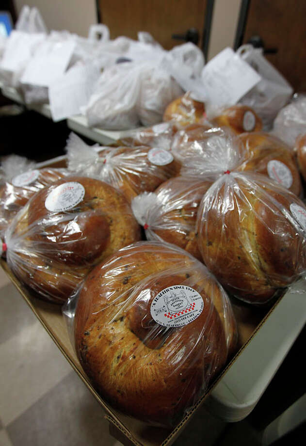 Orders of challah bread sit on a table ready for customers to pick them up at Three Brothers Bakery. Photo: Karen Warren, Houston Chronicle / © 2011 Houston Chronicle