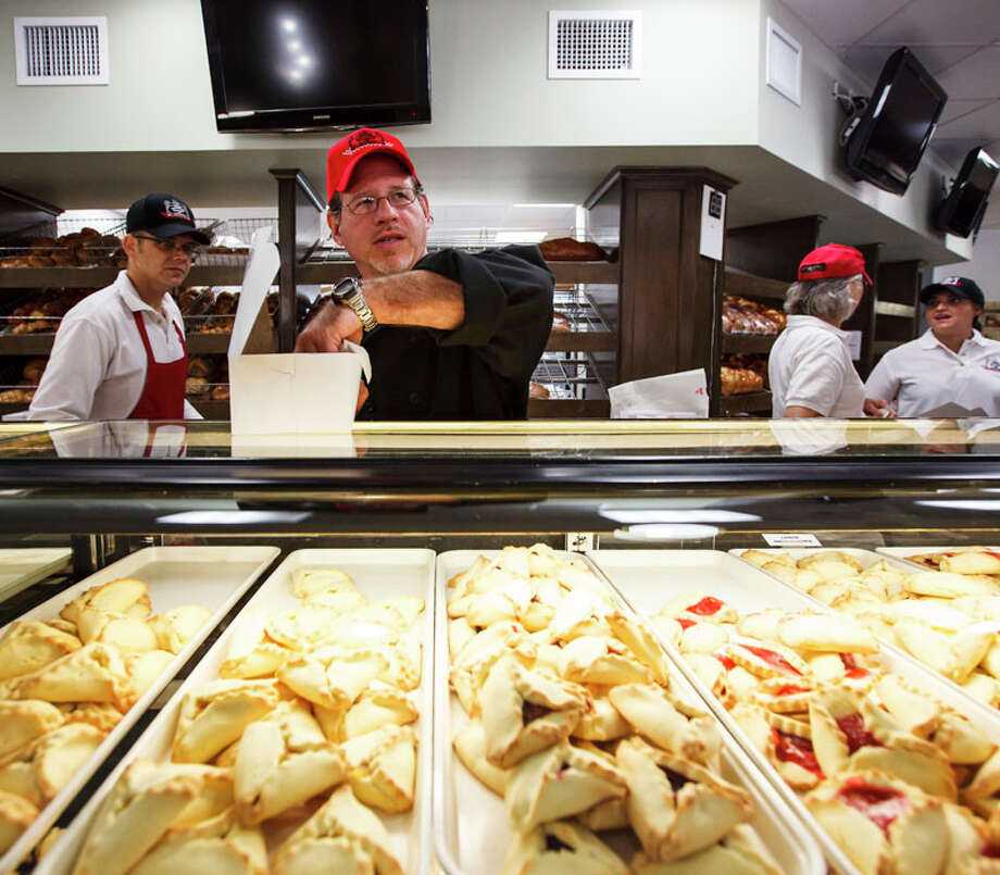 Bobby Jucker  boxes up an order of hamentashen, triangular pastries traditionally made for the Jewish holiday of Purim, at Three Brothers Bakery. Photo: Michael Paulsen, Houston Chronicle / © 2012 Houston Chronicle