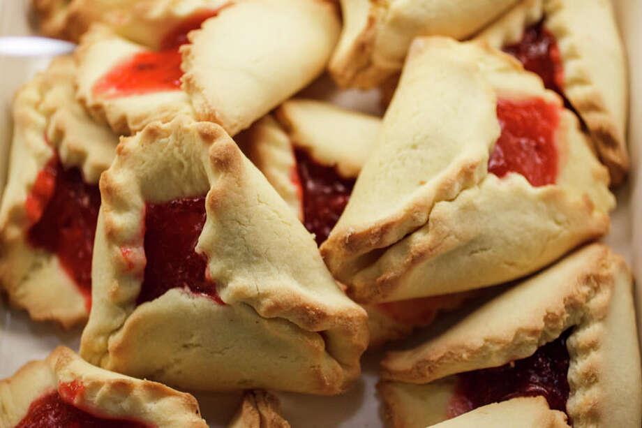 Cherry hamentashen, triangular pastries traditionally made for the Jewish holiday of Purim, at Three Brothers Bakery. Photo: Michael Paulsen, Houston Chronicle / © 2012 Houston Chronicle
