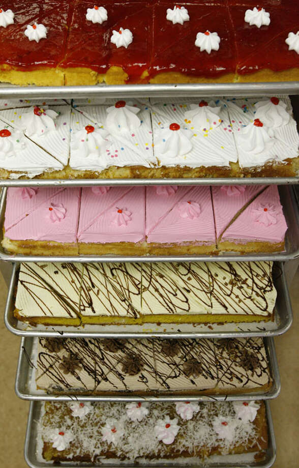 Trays of sweet fruit cakes at El Bolillo. Photo: Carlos Antonio Rios, Houston Chronicle / Houston Chronicle