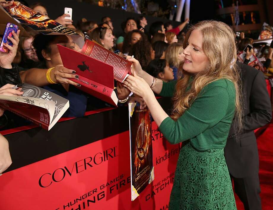"Writer Suzanne Collins attends premiere of Lionsgate's ""The Hunger Games: Catching Fire"" - Red Carpet at Nokia Theatre L.A. Live on November 18, 2013 in Los Angeles, California. Photo: Christopher Polk, Getty Images"