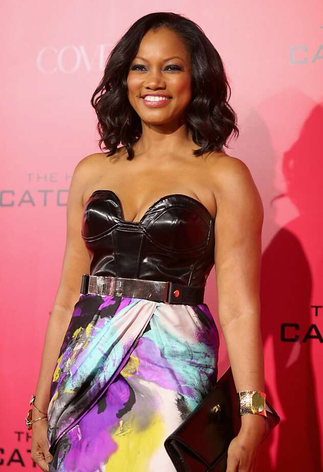 "Actress Garcelle Beauvais attends premiere of Lionsgate's ""The Hunger Games: Catching Fire"" - Red Carpet at Nokia Theatre L.A. Live on November 18, 2013 in Los Angeles, California. Photo: Christopher Polk, Getty Images"