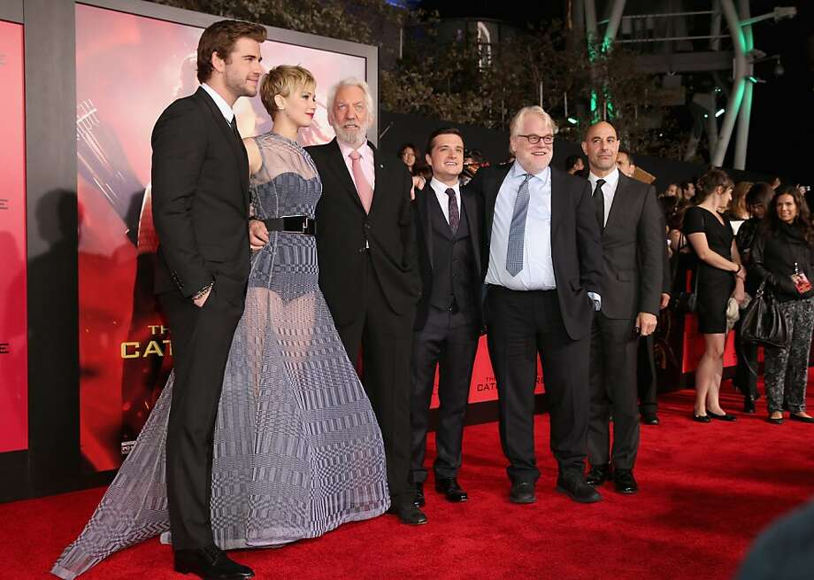 "(L-R) Actors Liam Hemsworth, Jennifer Lawrence, Donald Sutherland, Josh Hutcherson, Philip Seymour Hoffman and Stanley Tucci attend premiere of Lionsgate's ""The Hunger Games: Catching Fire"" - Red Carpet at Nokia Theatre L.A. Live on November 18, 2013 in Los Angeles, California. Photo: Christopher Polk, Getty Images"