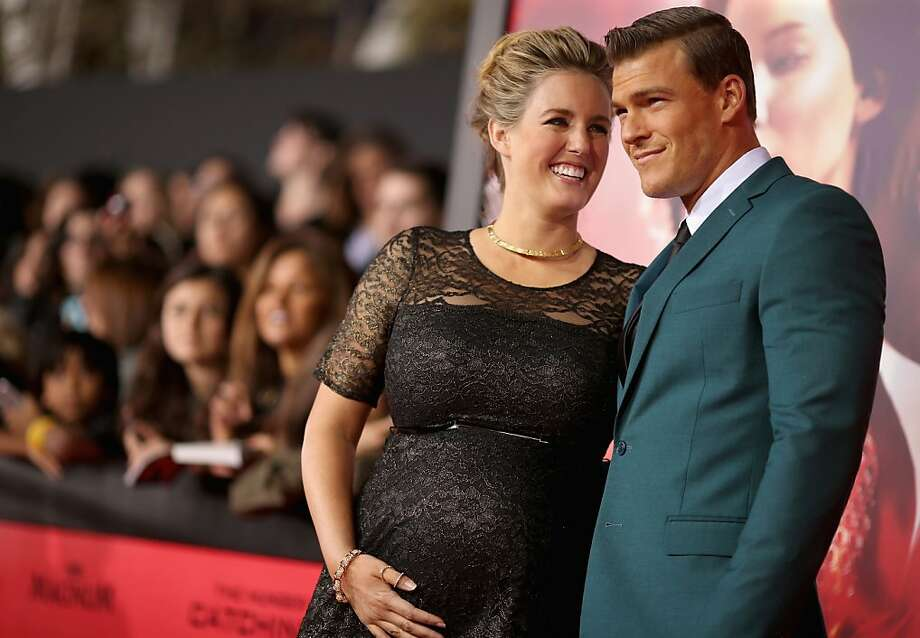 "Actor Alan Ritchson (R) and Catherine Ritchson attend premiere of Lionsgate's ""The Hunger Games: Catching Fire"" - Red Carpet at Nokia Theatre L.A. Live on November 18, 2013 in Los Angeles, California. Photo: Christopher Polk, Getty Images"