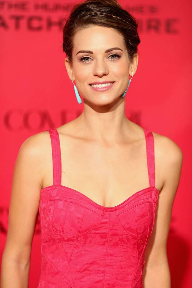 "Actress Lyndsy Fonseca attends premiere of Lionsgate's ""The Hunger Games: Catching Fire"" - Red Carpet at Nokia Theatre L.A. Live on November 18, 2013 in Los Angeles, California. Photo: Christopher Polk, Getty Images"