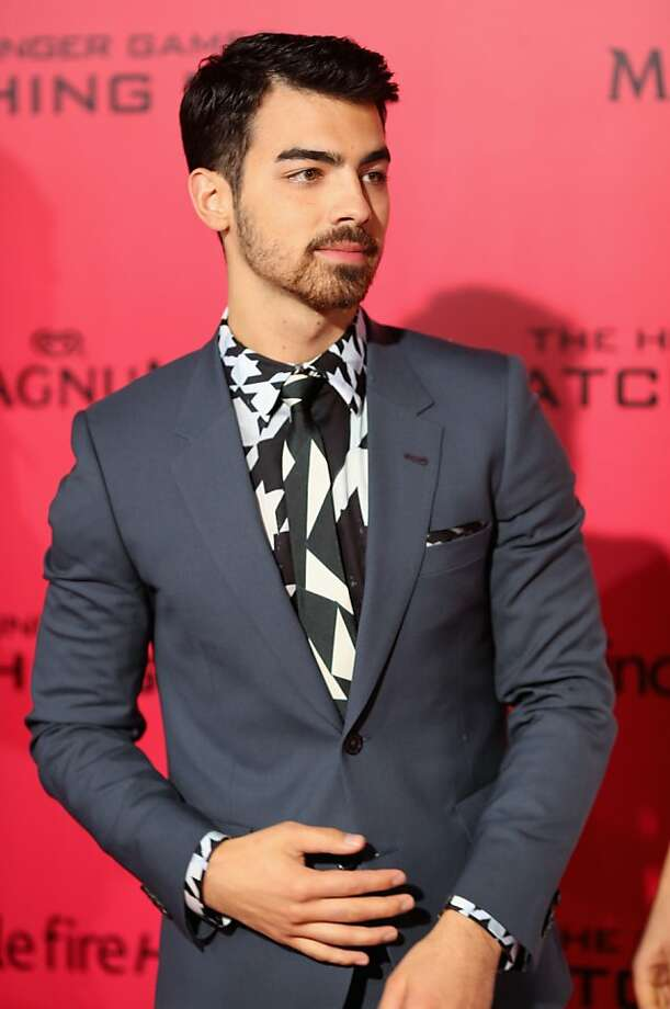 "Singer Joe Jonas attends premiere of Lionsgate's ""The Hunger Games: Catching Fire"" - Red Carpet at Nokia Theatre L.A. Live on November 18, 2013 in Los Angeles, California. Photo: Christopher Polk, Getty Images"