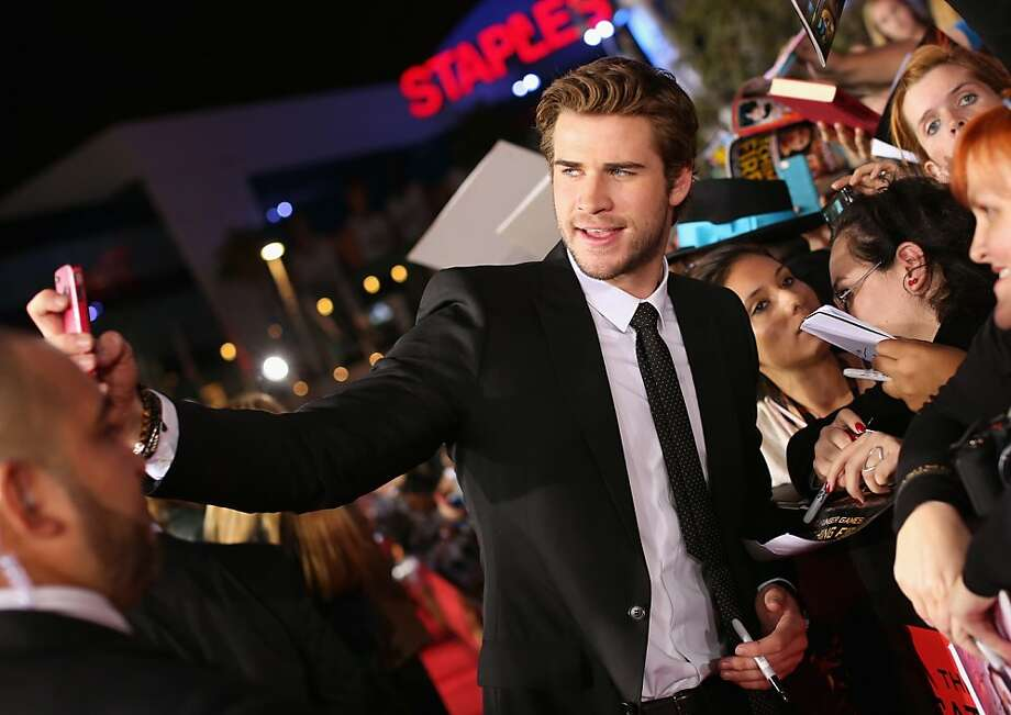 "Actor Liam Hemsworth attends premiere of Lionsgate's ""The Hunger Games: Catching Fire"" - Red Carpet at Nokia Theatre L.A. Live on November 18, 2013 in Los Angeles, California. Photo: Christopher Polk, Getty Images"