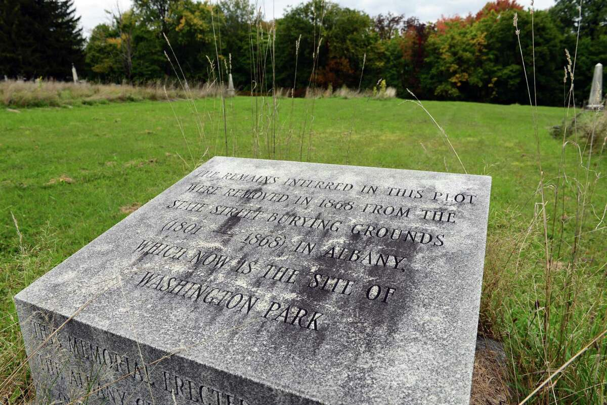 Grave marker which shows where graves were relocated from Washington Park in 1868 to Albany Rural Cemetery. (Will Waldron/Times Union)