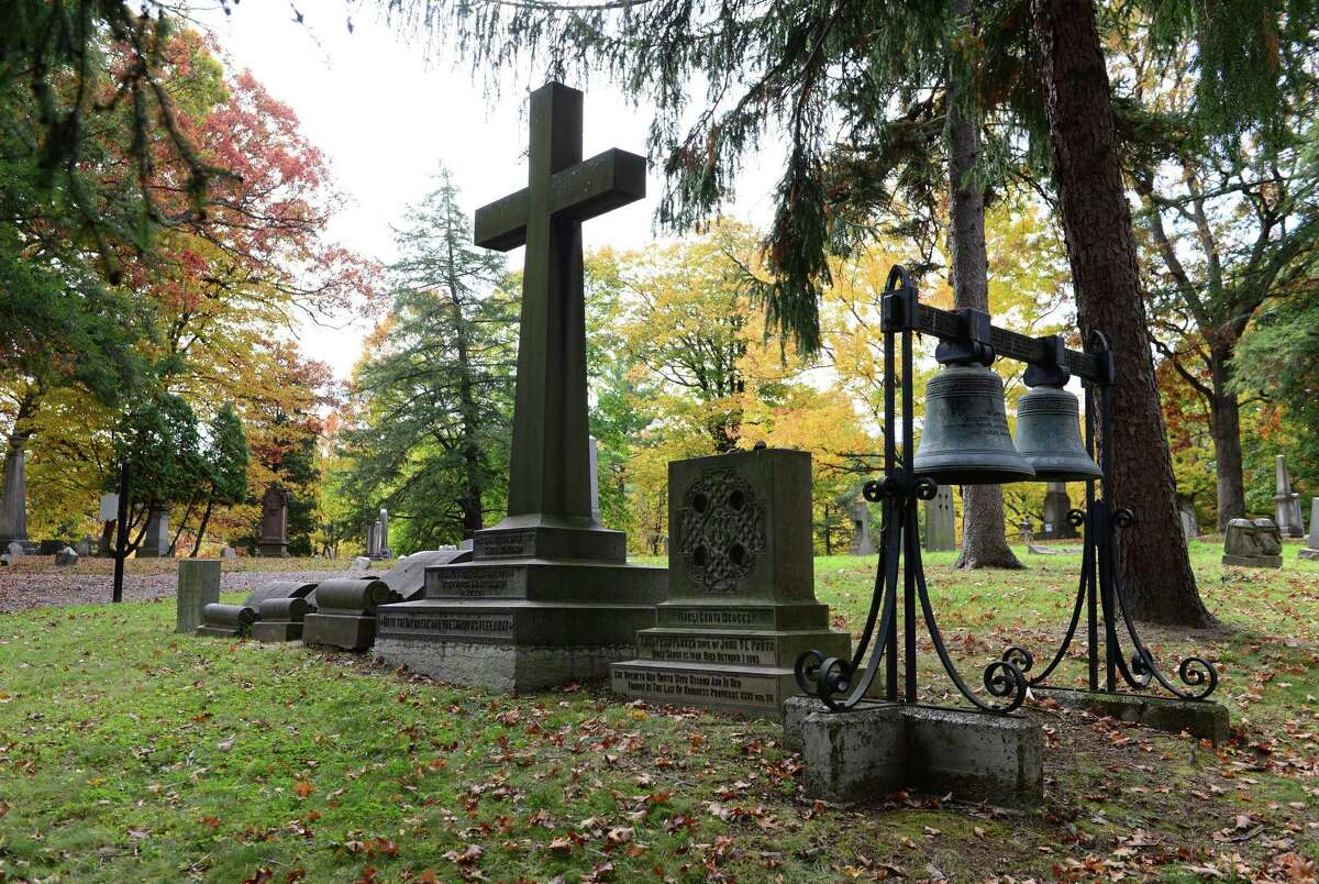 The grave of John Van Schaick Lansing Pruyn, a former member of Congress, regent and well-connected lawyer. A large granite cross and scrolls mark the familiy gravesite. (Will Waldron/Times Union)