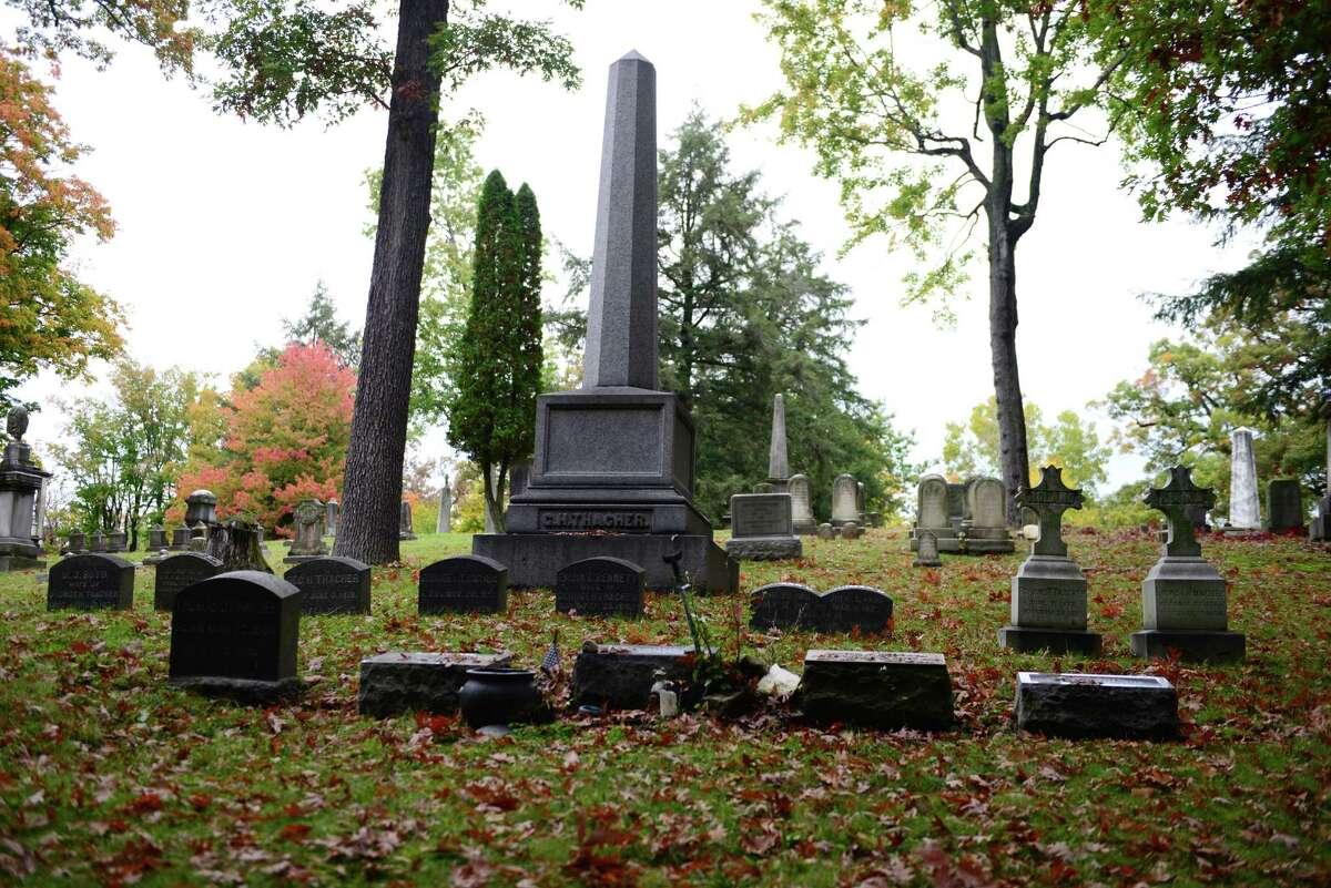 The grave of Edwin ?Ebby? Thacher, center, at Albany Rural Cemetery. Thacher is credited with inspiring Bill Wilson, a longtime drinking buddy, to start Alcoholics Anonymous. (Will Waldron/Times Union)