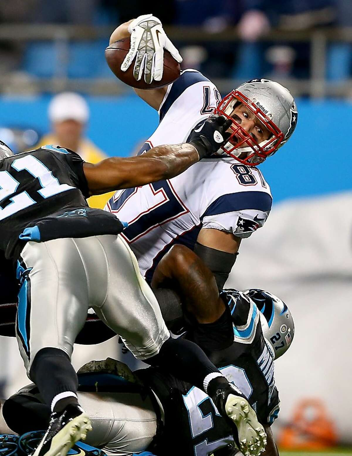 Rob Gronkowski #87 of the New England Patriots dives for a touchdown during their game against the Carolina Panthers at Bank of America Stadium on November 18, 2013 in Charlotte, North Carolina.
