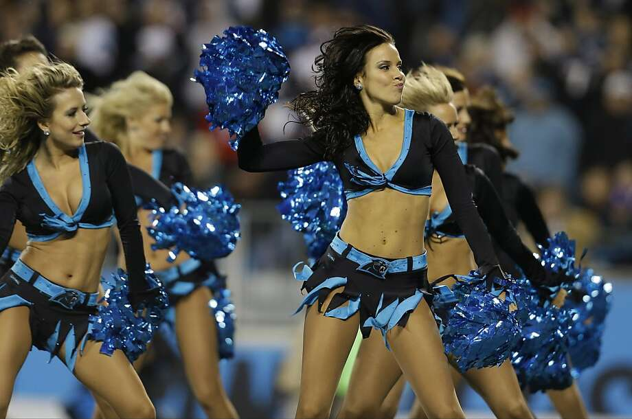 Carolina Panthers cheerleaders perform during the first half of an NFL football game against the New England Patriots in Charlotte, N.C., Monday, Nov. 18, 2013. Photo: Gerry Broome, Associated Press