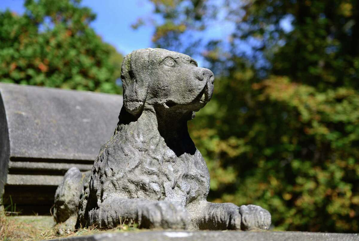 A pair of carved stone dogs decorate the Burden mausoleum. (Will Waldron/Times Union)