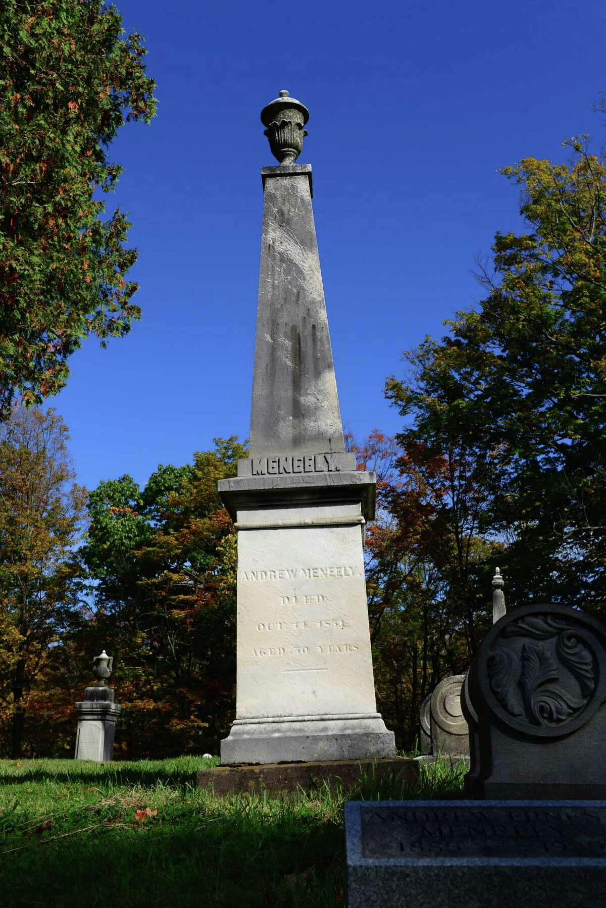 An obelisk marks the grave of Andrew Meneely, founder of the acclaimed Meneely Bells of Troy. (Will Waldron/Times Union)