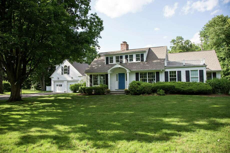 The expanded Cape at 6 Pasture Lane in Darien has an extensive yard and a backyard pool. It is on the market for $2,095,000. Photo: Contributed Photo, Contributed / Darien News