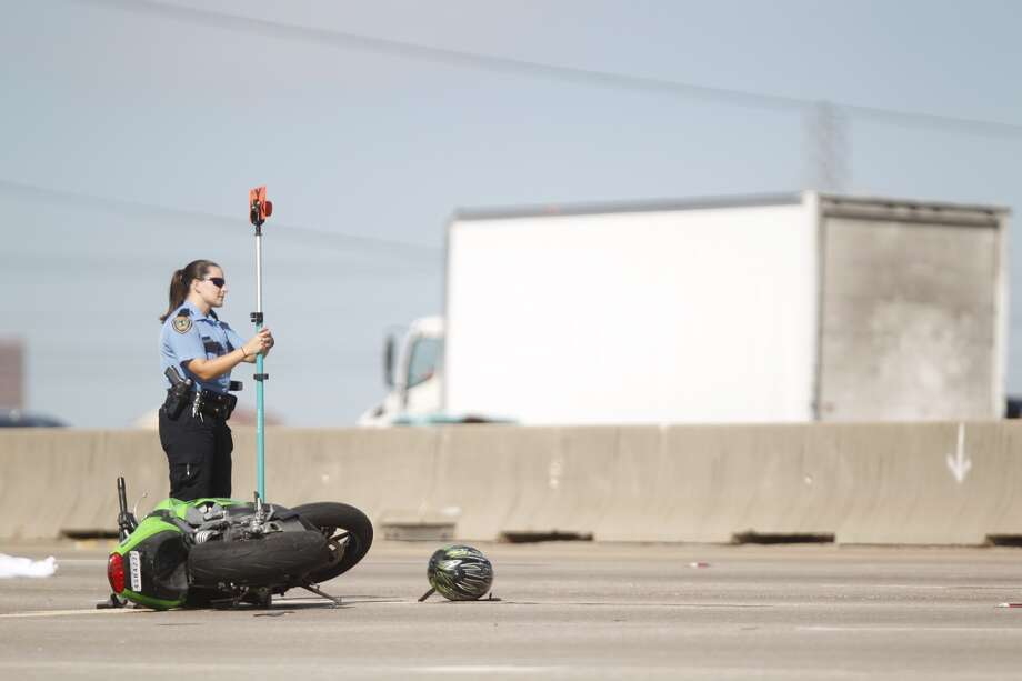 A motorcyclist died after colliding with a big rig Monday morning, Nov. 19, 2013 on U.S. 59 in southwest Houston. (Johnny Hanson / Houston Chronicle)