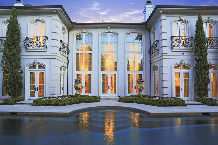 2406 Del Monte: This 2006 mega home has 7-9 bedrooms, 7 full and 5  half bathrooms, 16,347 square feet, and features a five-chamber master suite, caterer's kitchen, guest house, and sparkling pool. Listed for $9,999,980. Contact agent Brian Spack at 713-784-0888 for more information. Photo: HAR.com
