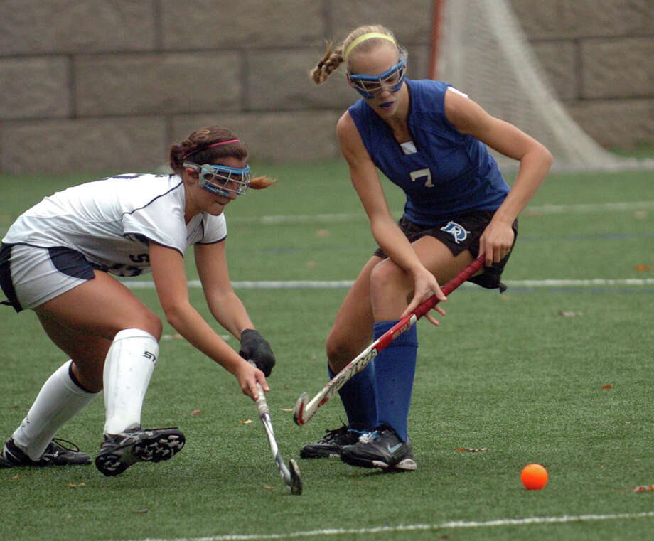 Field hockey highlights between Staples and Darien in Westport, Conn. on Wednesday October 27, 2010. Staples #13 Misha Strage, left, and Darien's #7 Sophie Doering, go after the ball. Photo: Christian Abraham, ST / Connecticut Post