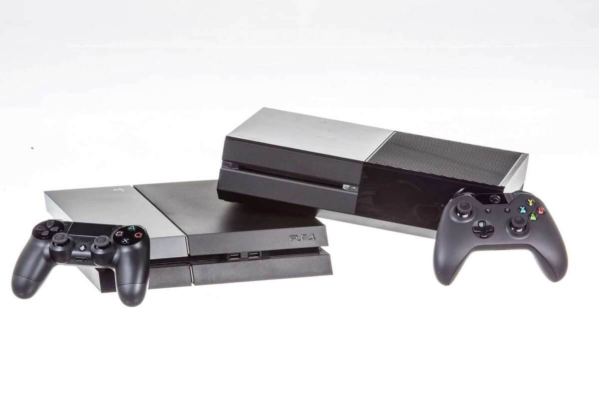 The Sony Playstation 4, at left, and the Microsoft XBox One, in New York, Nov. 12, 2013. The new consoles are vying to be an all-in-one conduit for entertainment content into living rooms, even as competition for the time of both gamers and TV-watchers proliferates. (Tony Cenicola/The New York Times) ORG XMIT: XNYT140