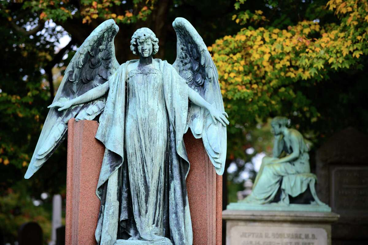 This eight-foot-tall bronze angel graces the burial site of department store owner John Myers and his wife, Mary. The monument is easily viewed from the Cypress Fountain. (Will Waldron/Times Union)