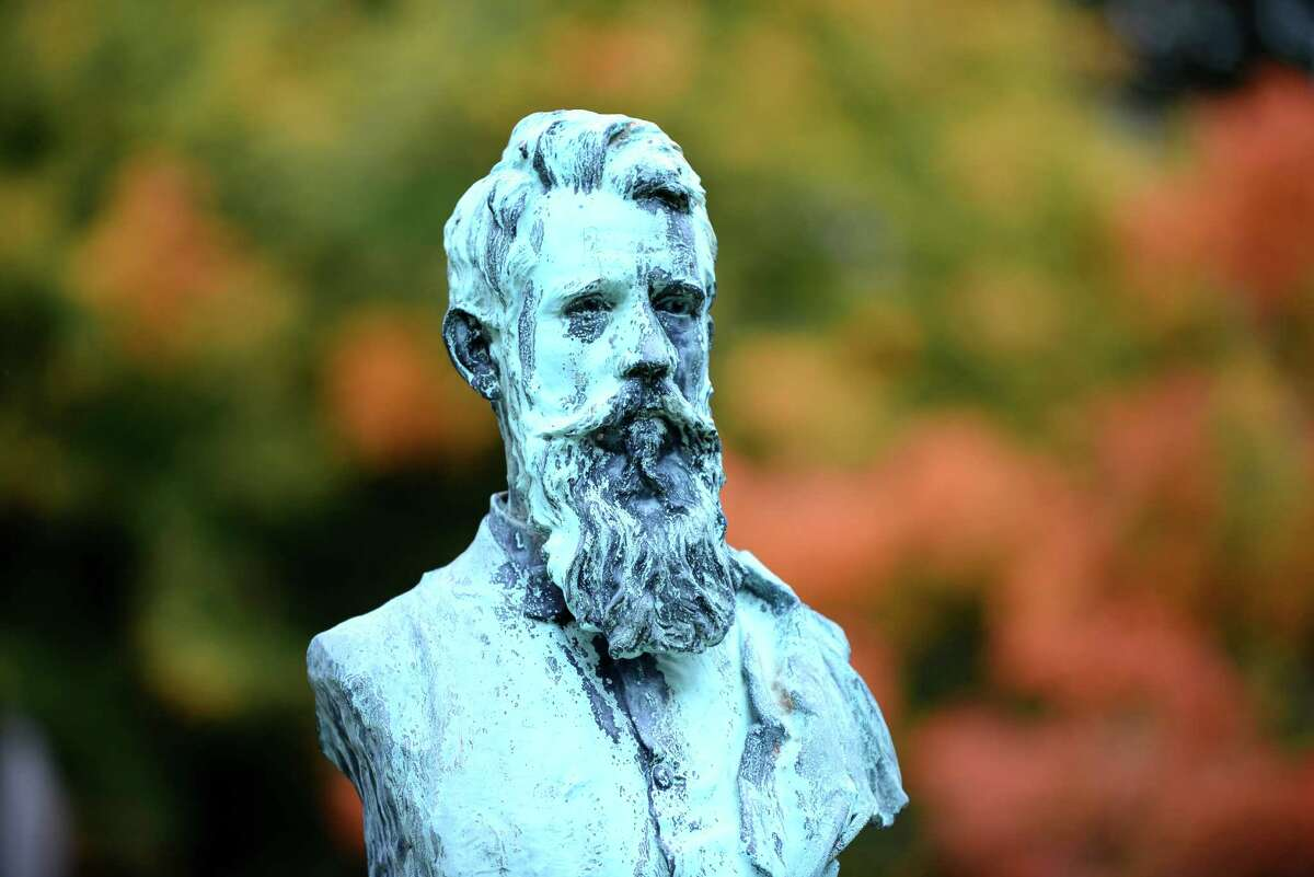The self-styled bust of Albany sculptor and stone cutter Charles Calverley graces the family grave. (Will Waldron/Times Union)