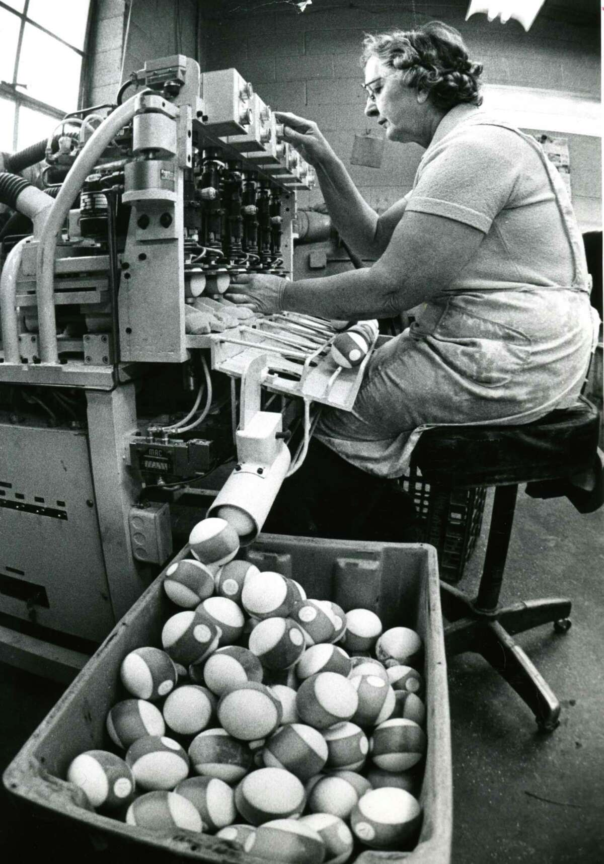 Click through the slideshow of Times Union archive photos from 1978. Charlotte Stadler works on the line at the Albany Billiard Ball Company, January 1978. (Bob Richey/Times Union archive)