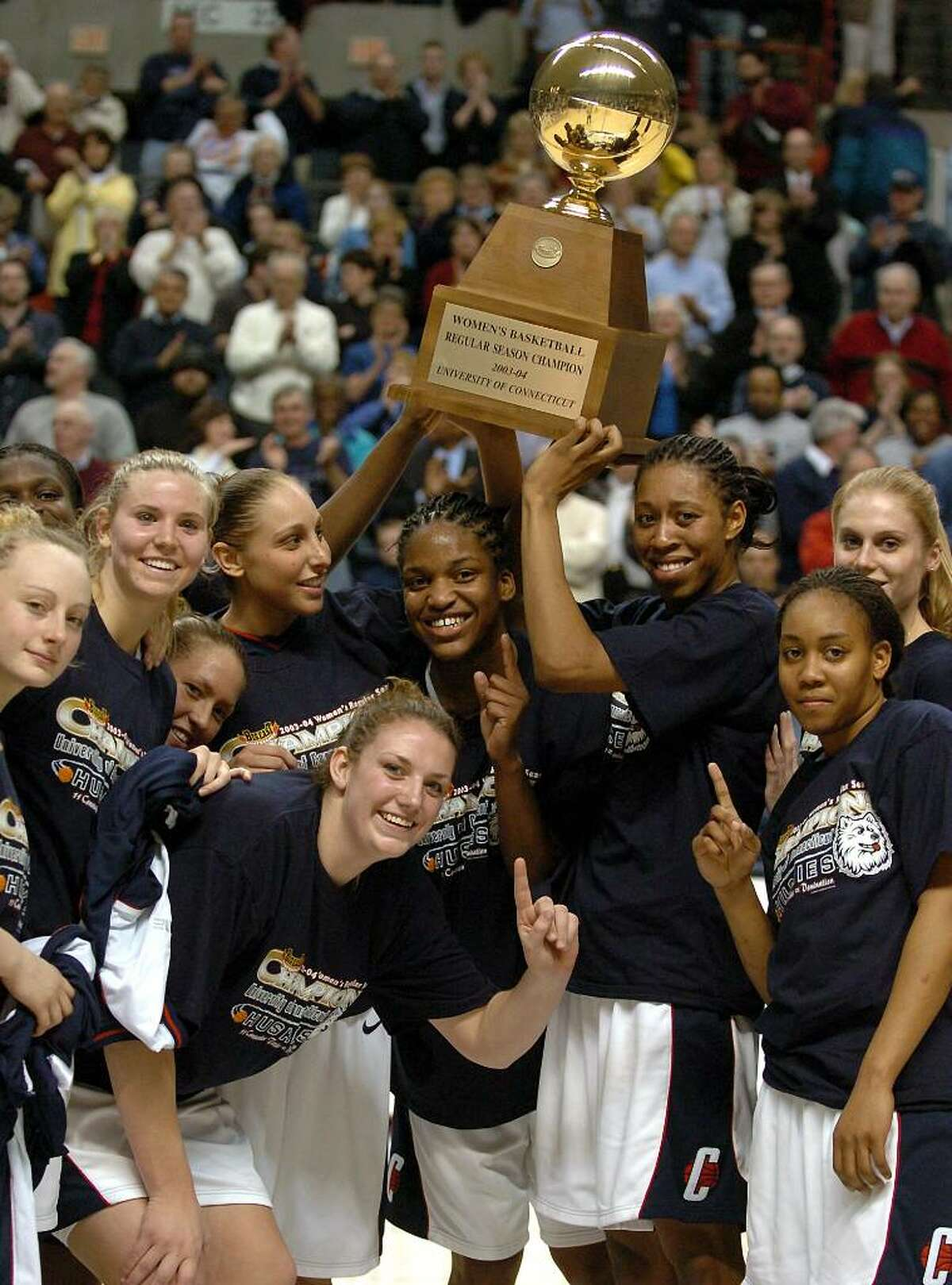 Members of the University of Connecticut women's basketball team pose with the Big East Conference regular season trophy after the Connecticut-West Virginia game at Storrs, Conn., Tuesday, March 2, 2004. From left are: Maria Conlon, Ann Strother, Morgan Valley, Diana Taurasi , Liz Sherwood, Willnet Crockett, Jessica Moore, Kiana Roboinson, Nicole Wolff. (AP Photo/Bob Child)