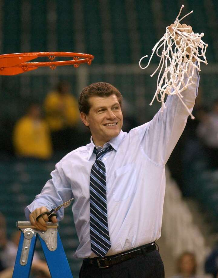 Connecticut head coach Geno Auriemma cuts down the net after Connecticut defeated Tennessee, 73-68, in the NCAA Women's Final Four championship game on Tuesday, April 8, 2003, in Atlanta. (AP Photo/John Bazemore) Photo: JOHN BAZEMORE, AP / AP