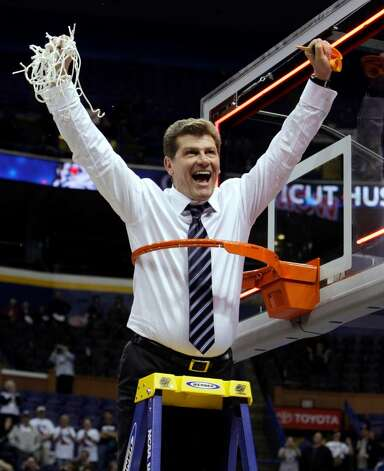 Connecticut coach Geno Auriemma celebrates his team's win in championship game at the women's NCAA college basketball tournament Final Four on Tuesday, April 7, 2009, in St. Louis. Connecticut won 76-54. (AP Photo/Mark Humphrey) Photo: Mark Humphrey, AP / AP