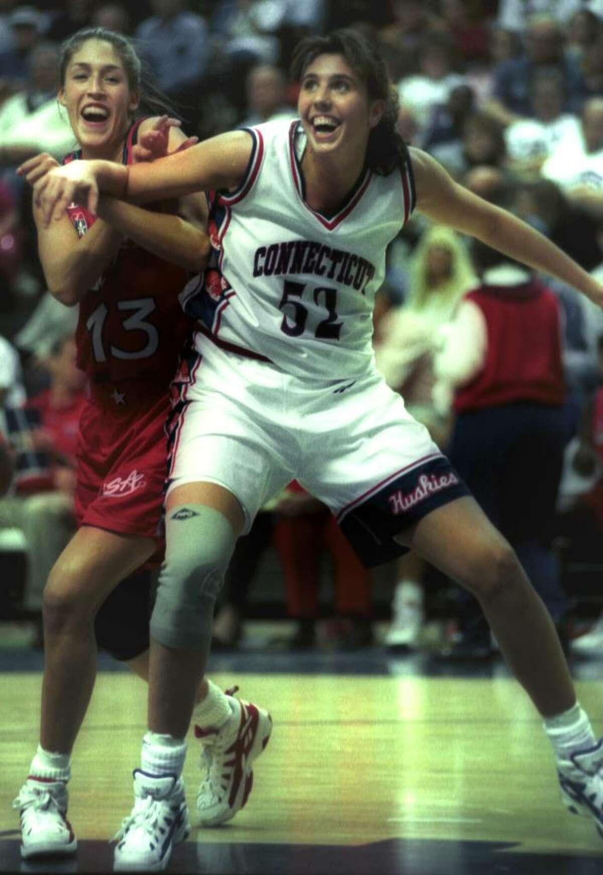 University of Connecticut basketball player Kara Wolter in action against former teammate Rebecca Lobo, member of the U.S. Olympic team, date and location unknown.