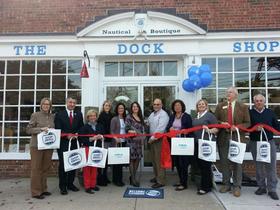 At the ribbon-cutting ceremony for The Dock Shop, 51 Tokeneke Road, Darien, were, from left, state Rep. Terrie Wood, R-141; state Sen. Carlo Leone, D-27; Selectman Susan Marks; Kaitlyn Arcamone and Joyce Cebo, The Dock Shop; Toni Sabia and Michael La Scala, owners of The Dock Shop; Kaye Leong, of the Darien Rowayton Bank and a Chamber of Commerce board member; Laurie Griffith, of Darien Bank & Trust and a chamber board member; John Lundeen, of Lundeen Cliffside Associates and a chamber board member; and Randy Bloomquist, of Reid Everett, LLC. Photo: Contributed Photo, Contributed / Darien News