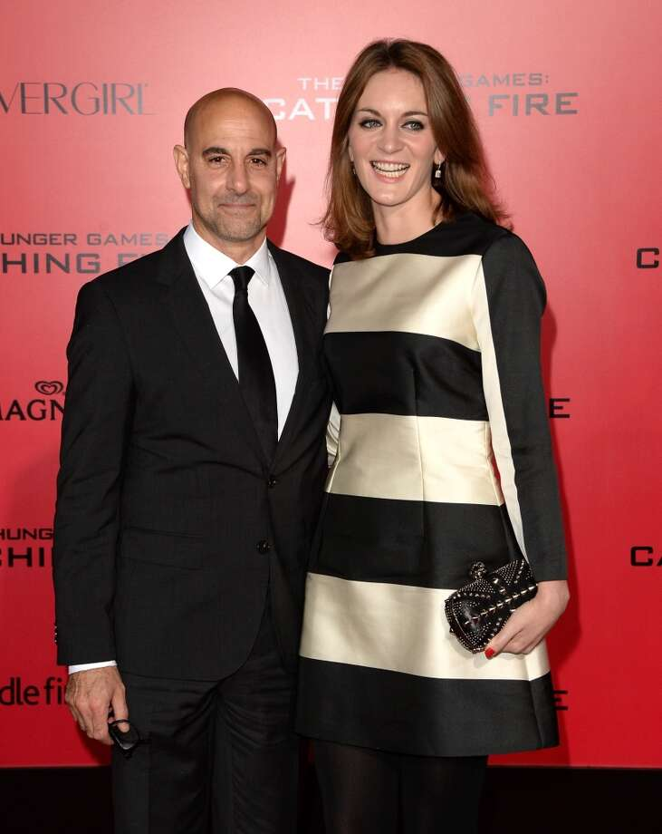 "Actor Stanley Tucci (L) and Felicity Blunt arrive at the premiere of Lionsgate's ""The Hunger Games: Catching Fire"" at Nokia Theatre L.A. Live on November 18, 2013 in Los Angeles, California. Photo: Jason Merritt, Getty Images"