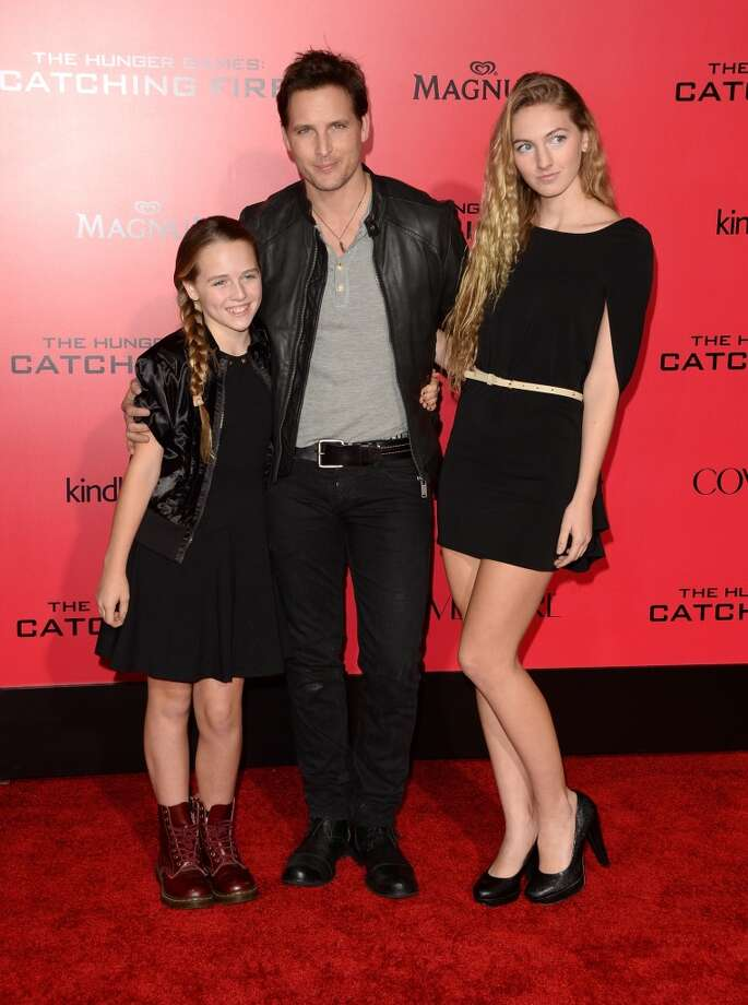 "Actor Peter Facinelli (C) and his daughters arrive at the premiere of Lionsgate's ""The Hunger Games: Catching Fire"" at Nokia Theatre L.A. Live on November 18, 2013 in Los Angeles, California. Photo: Jason Merritt, Getty Images"