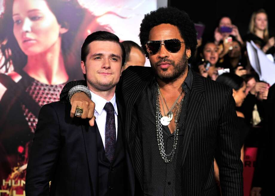 Actors Josh Hutcherson and Lenny Kravitz attend the premiere of Lionsgate's 'The Hunger Games: Cathching Fire' at Nokia Theatre L.A. Live on November 18, 2013 in Los Angeles, California. Photo: Frazer Harrison, Getty Images