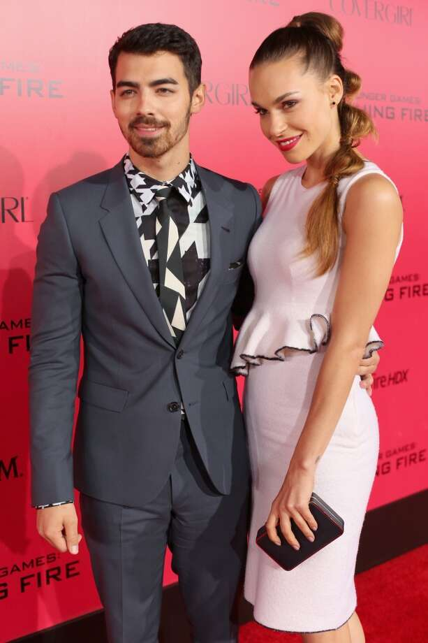 "Singer Joe Jonas (L) and model Blanda Eggenschwiler attend premiere of Lionsgate's ""The Hunger Games: Catching Fire"" - Red Carpet at Nokia Theatre L.A. Live on November 18, 2013 in Los Angeles, California. Photo: Christopher Polk, Getty Images"