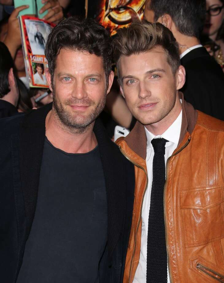 "TV personality Nate Berkus (L) and Jeremiah Brent attend the premiere of Lionsgate's ""The Hunger Games: Catching Fire"" at Nokia Theatre L.A. Live on November 18, 2013 in Los Angeles, California. Photo: David Livingston, Getty Images"