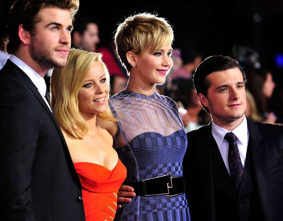 Actors Liam Hemsworth, Elizabeth Banks, Jennifer Lawrence, Josh Hutcherson attend the premiere of Lionsgate's 'The Hunger Games: Cathching Fire' at Nokia Theatre L.A. Live on November 18, 2013 in Los Angeles, California. Photo: Frazer Harrison, Getty Images