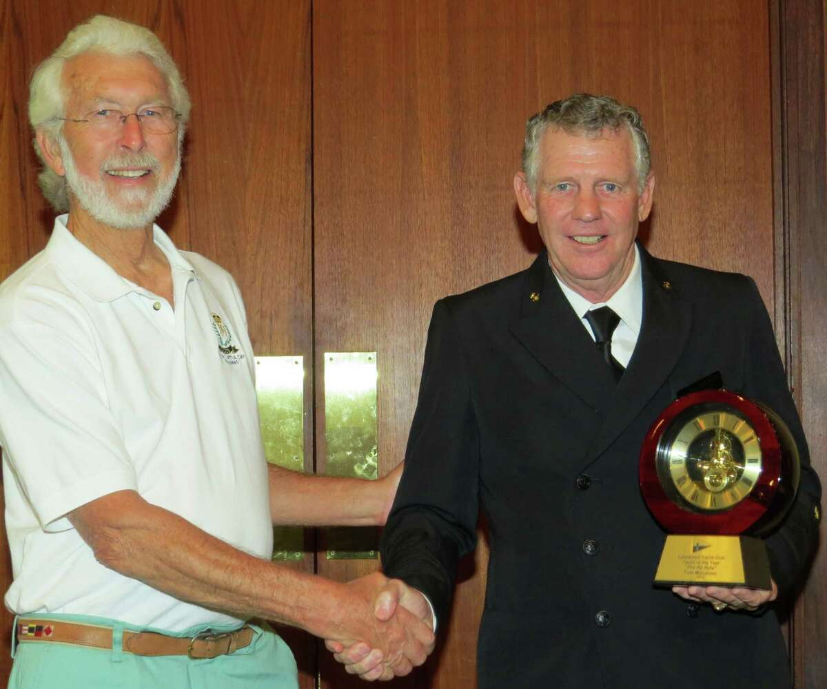 Tom Macaluso, left, accepts the Yacht of the Year award from Lakewood Yacht Club Fleet Captain Don Mitchell.