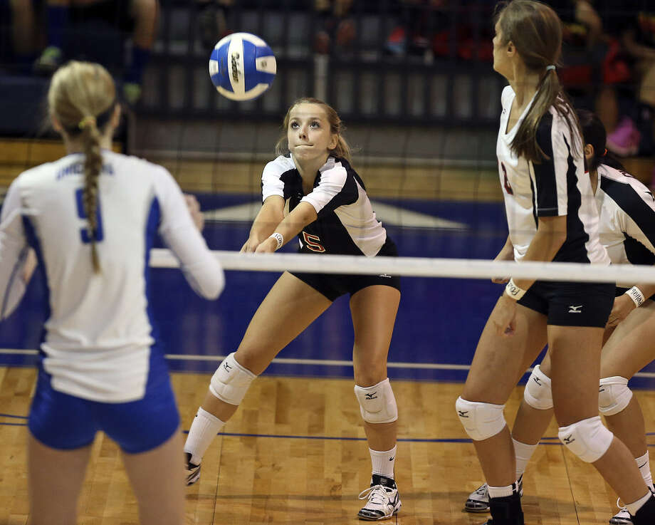 Amy Nettles fields a serve for Churchill in a Sept. 24 match with New Braunfels. After facing each other in the UIL Region IV-5A final Saturday, Nettles and Reagan's Ashlie Reasor will be teammates at Texas A&M next year. Photo: S.A. Express-News File Photo
